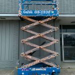 Scissor lift with Christmas lights on it