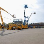Multiple boom lifts outside