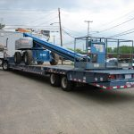 Boom lift on trailer