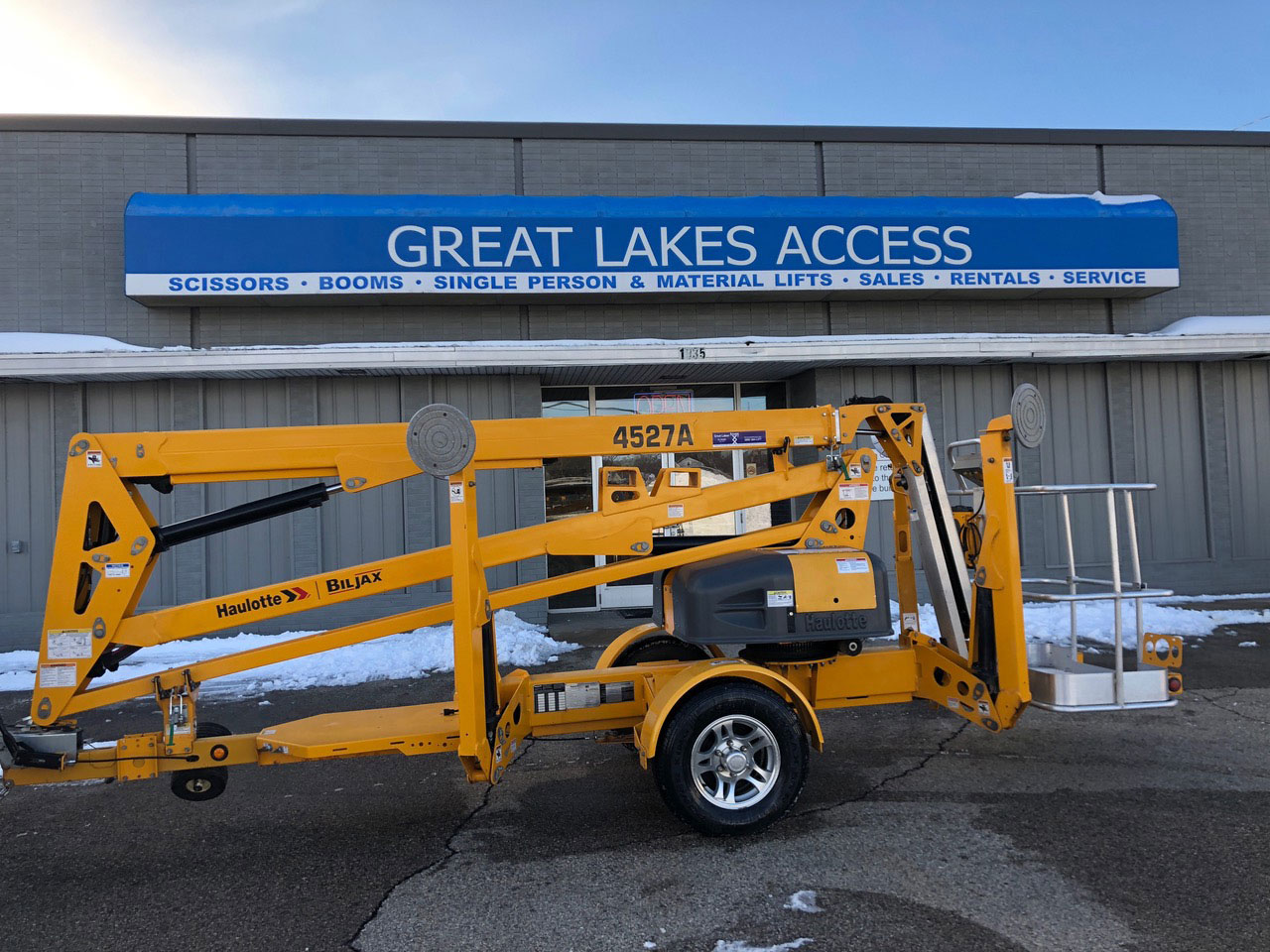 Great Lakes Access storefront behind trailer boom lift