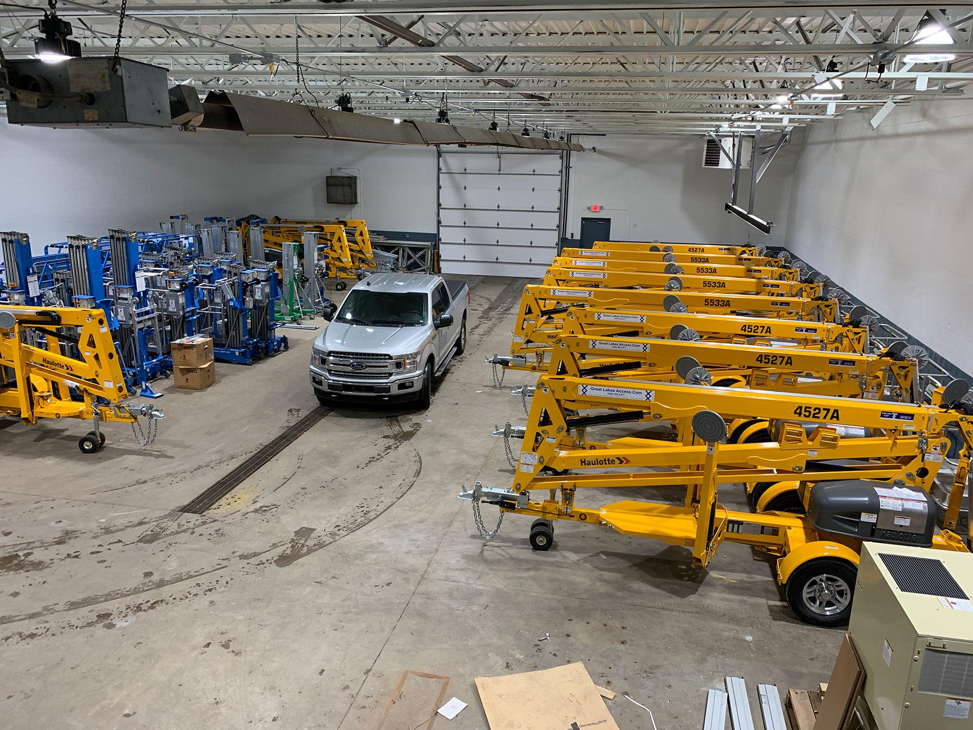 Rental equipment and truck inside garage