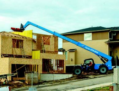 Forklift building a house